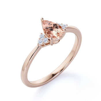 1.50 Carat Pear Shaped Pink Morganite with Diamond Shoulder Accents Cluster Wedding Ring in Rose Gold