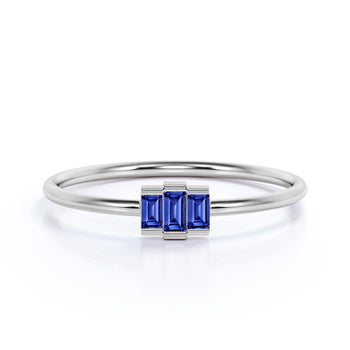0.56 Carat Dainty Emerald Cut Sapphire Trilogy Ring in White Gold
