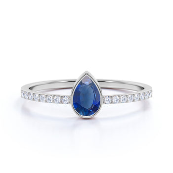Pear Cut Sapphire and Pave set Diamonds Promise Ring in White Gold