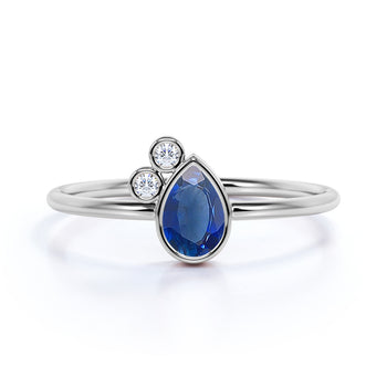 Unique Bezel Set Pear Cut Sapphire and Diamond Stacking Ring in White Gold