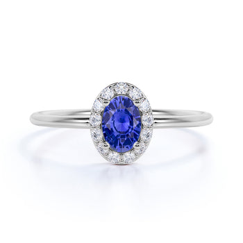 Classic 0.48 Carat Halo Set Oval Cut Sapphire and Diamond Dainty Ring in White Gold