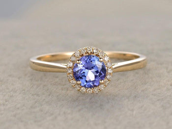 1.25 Carat Round Cut Tanzanite and Halo Diamond Engagement Rings in Yellow Gold