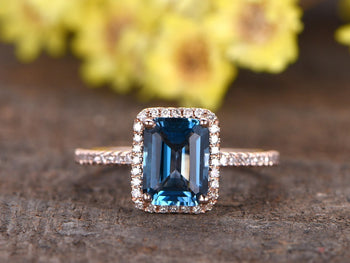 1.50 Carat Emerald Cut London Blue Topaz and Diamond Halo Half Infinity Engagement Ring in Rose Gold