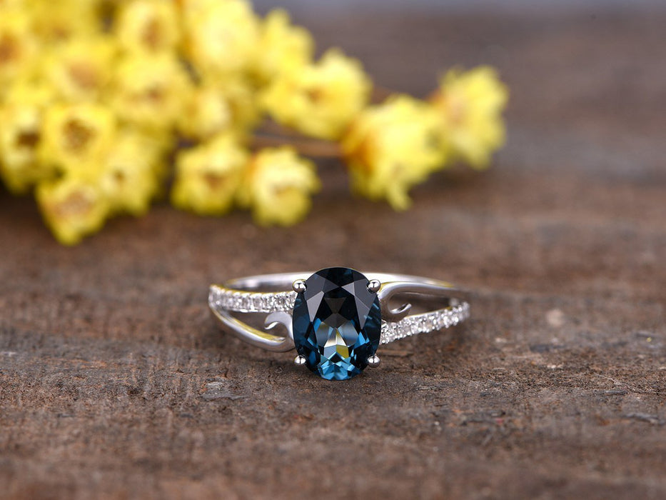 1.25 Carat Oval London Blue Topaz and Diamond Curved Split Shank Engagement Ring in White Gold