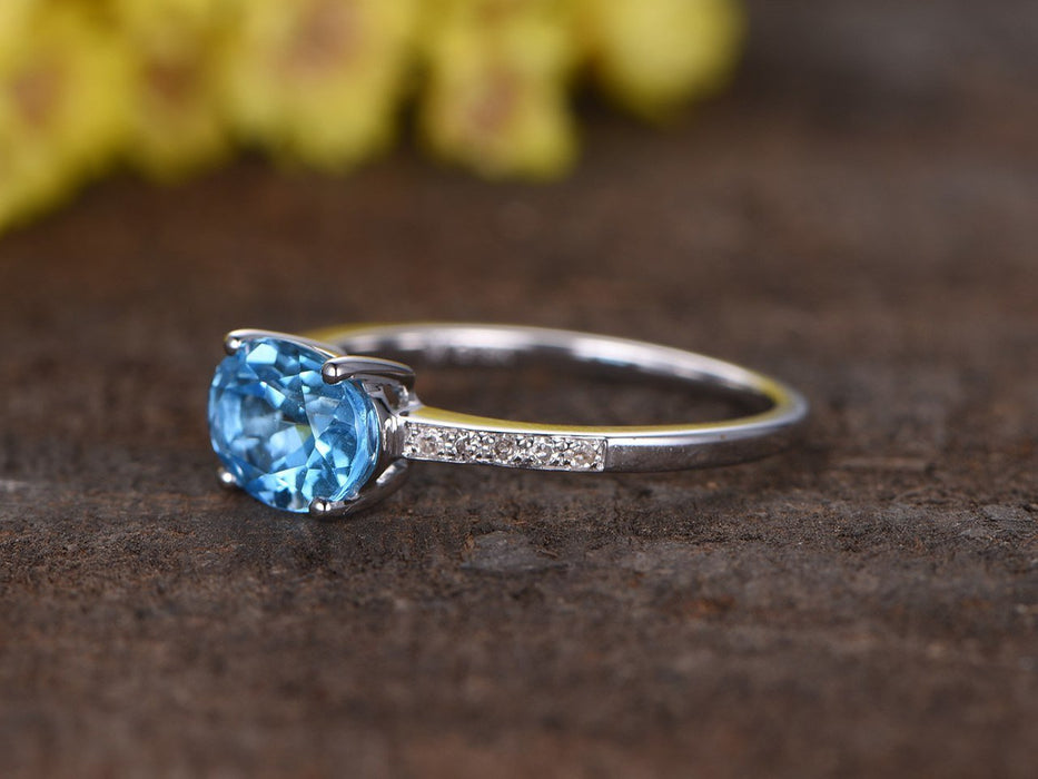 1.25 Carat Oval Sky Blue Topaz and Diamond Unique Engagement Ring in White Gold