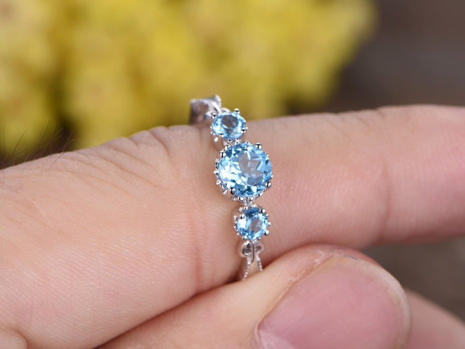 1.25 Carat Round Sky Topaz Three Stone Migraine Engagement Ring in White Gold