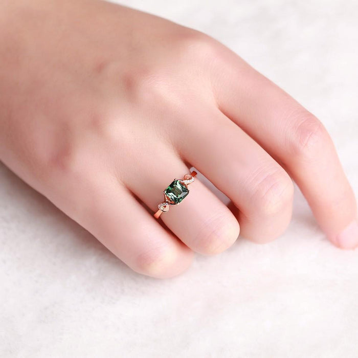 Unique 1.50 Carat Emerald and Diamond Infinity Engagement Ring
