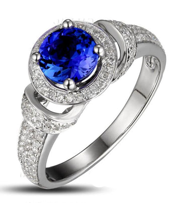 Vintage 1.50 Carat Round Cut Blue Sapphire and Diamond Art Nouveau Engagement Ring