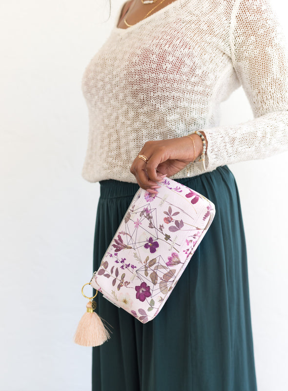 woman holding tassel pouch