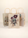 three plum leaf gift bags