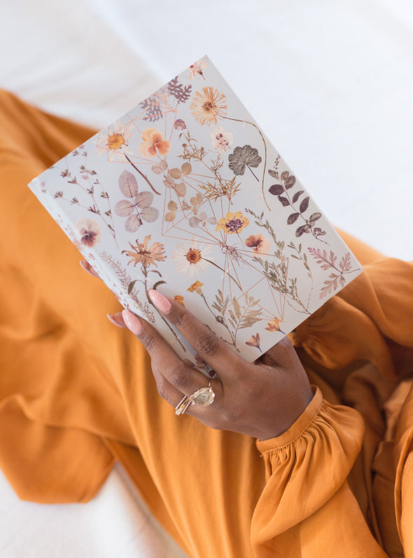 woman holding Golden Garden Sketchbook