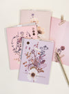 greeting cards with pen on table