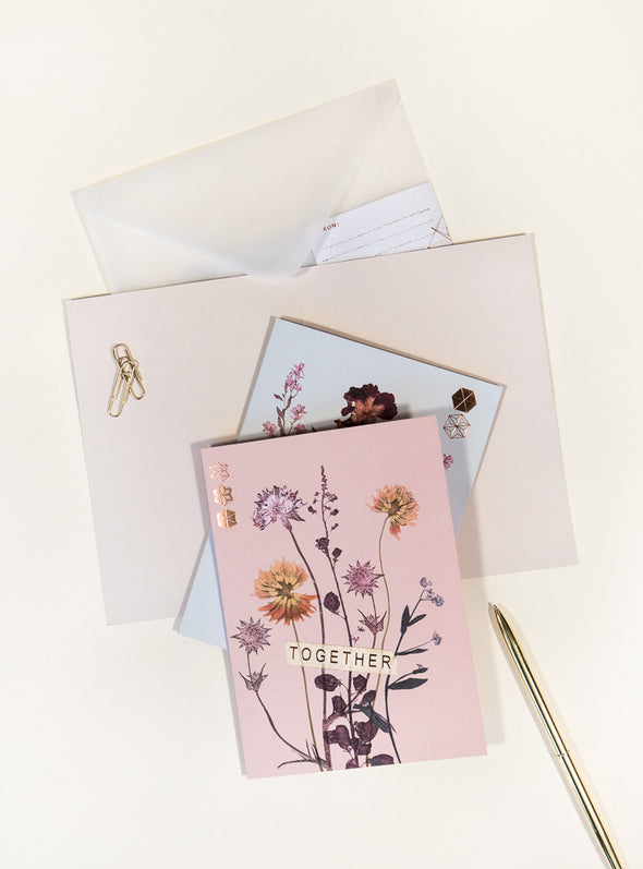 greeting cards on table with pen