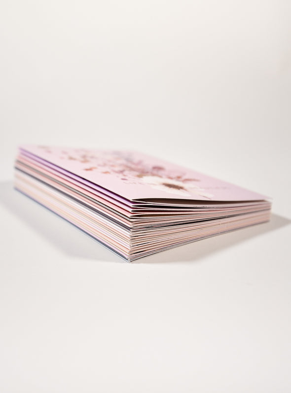 stack of pink greeting cards