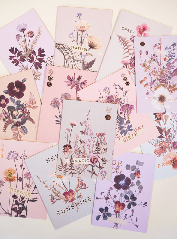 several pink petal greeting cards on table