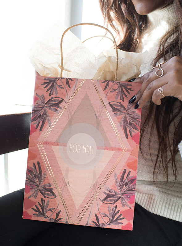 woman holding gift bag