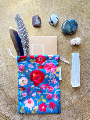 floral satin gift pouch with stones and feathers