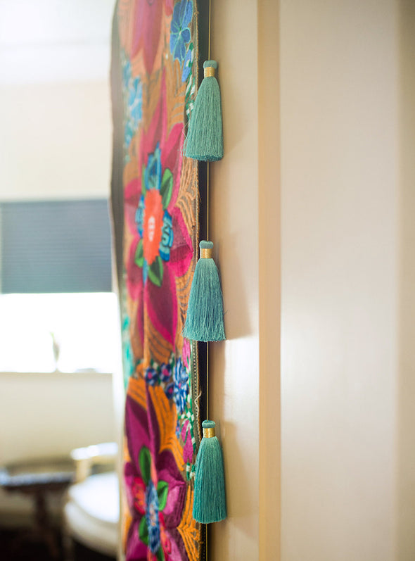Tassel Tier Drops hanging on wall
