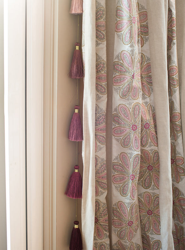 Tassel Tier Drops hanging by curtain