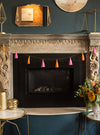 plumeria tassel garland hanging on mantel
