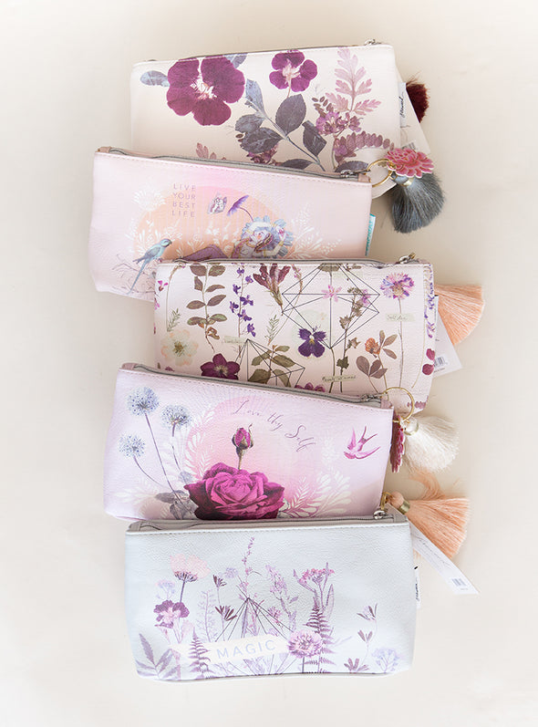 set of tassel pouches laying on table