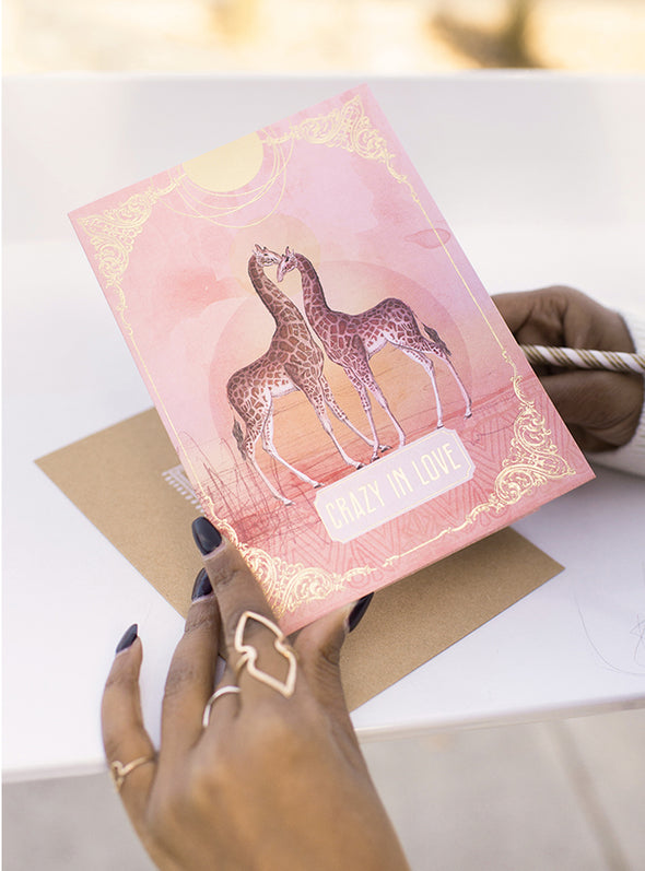 woman holding crazy in love greeting card