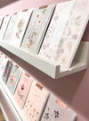 greeting cards on shelf