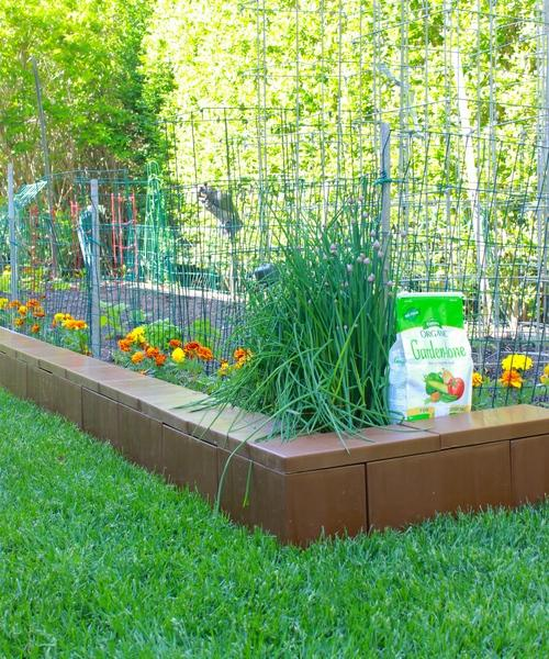 Enclose a garden bed and fill with soil to create a raised flower bed, vegetable garden or landscape feature. Add block layers as needed to create deeper gardens.