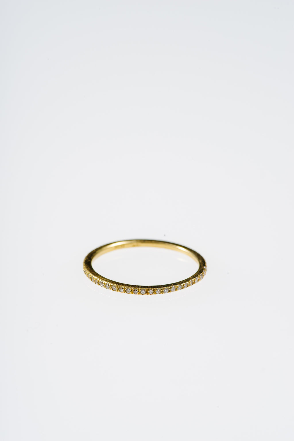SLIM DIAMOND ETERNITY BAND IN GOLD