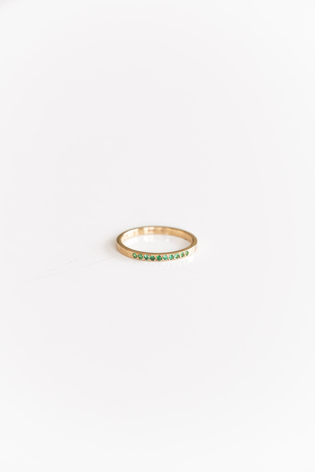 14K + EMERALD TEN STONE BAND