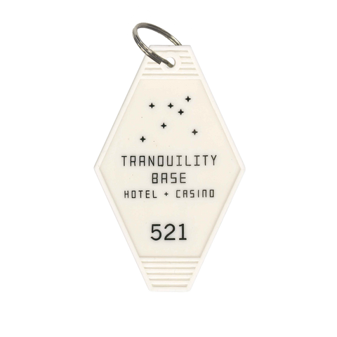 'TRANQUILITY BASE HOTEL + CASINO' KEY RING (CREAM)