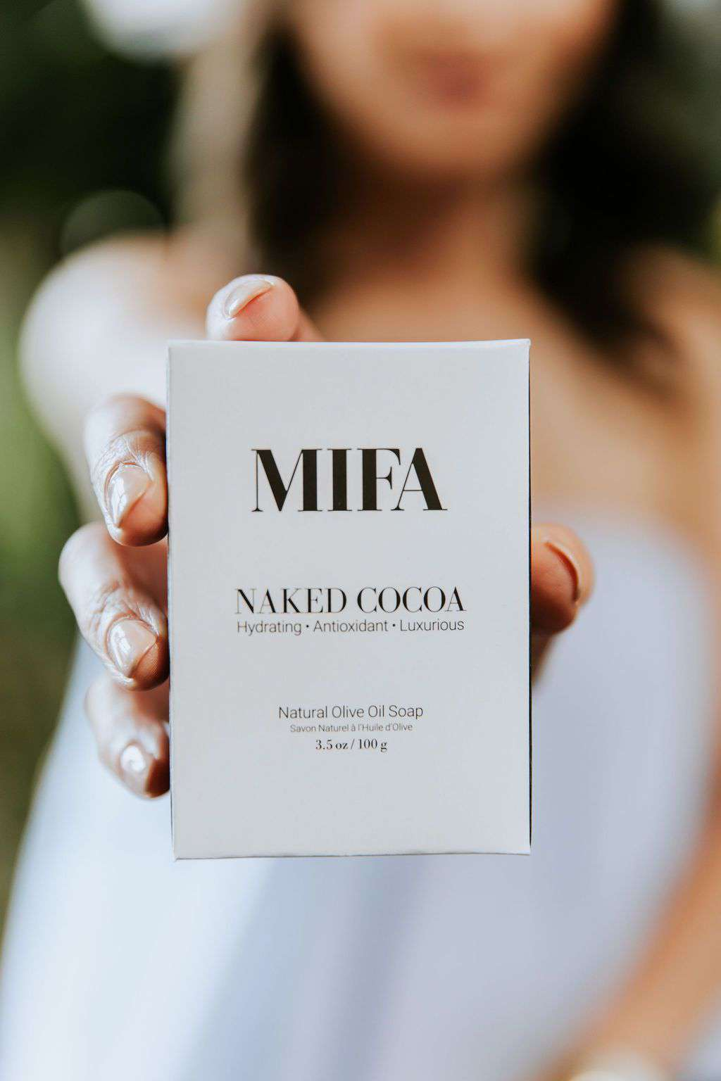 Woman holding Naked Cocoa Olive Oil Soap Bar by MIFA and Co from Jiyubox