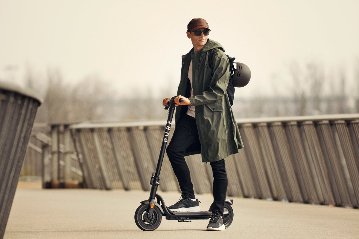 Picture of a man with electric scooter accessories he has bought