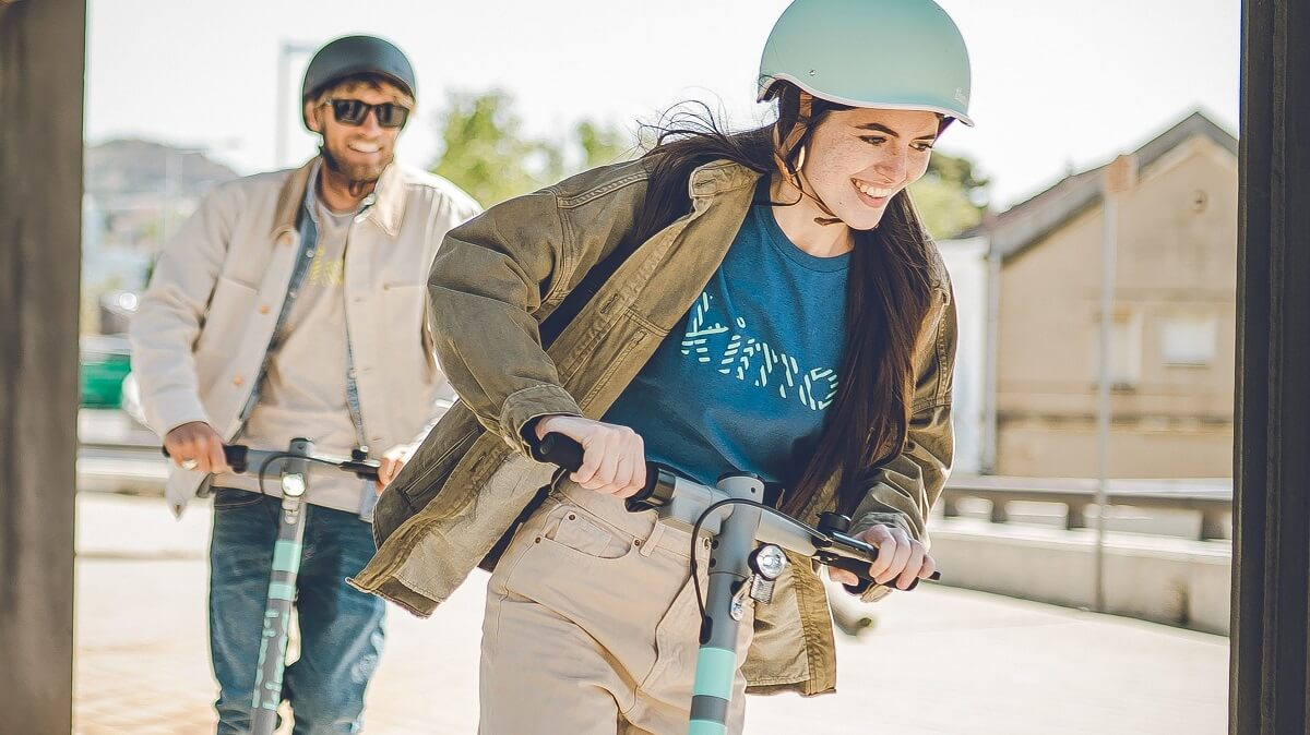 Couple testing out their e-scooter's top speed after buying an electric scooter