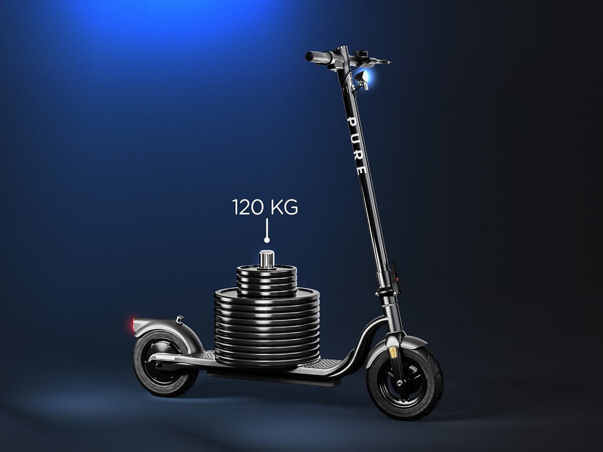 A scooter with a 120kg weight on highlighting maximum load as a consideration when buying an e-scooter