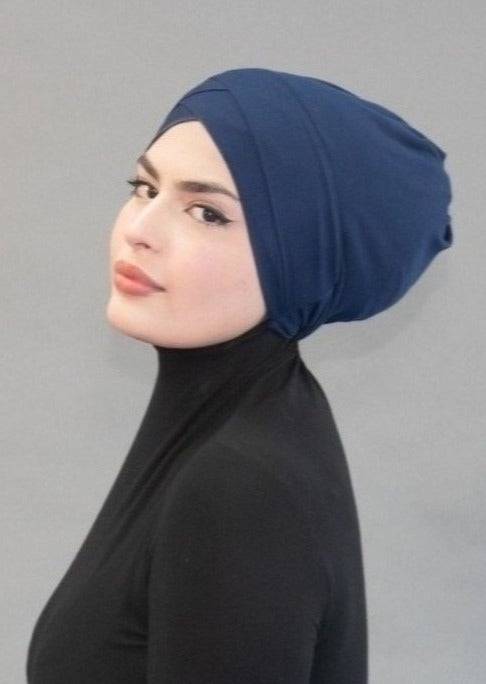 Criss Cross Tie-back Cap- Deep Sea Navy - Modestia Collection is a scarf brand with a higher purpose, representing the eclectic style of a diverse and inclusive community of scarf lovers.