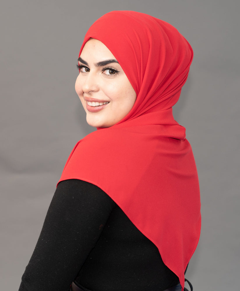 Limited Edition Gold Medallion Hijab / Scarf - Ferrari Red - Modestia Collection is a scarf brand with a higher purpose, representing the eclectic style of a diverse and inclusive community of scarf lovers.