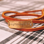 "Load image into Gallery viewer, ""Surrender"" Hand Stamped, Genuine Leather Wrap Bracelet - More Than Rubies Designs"