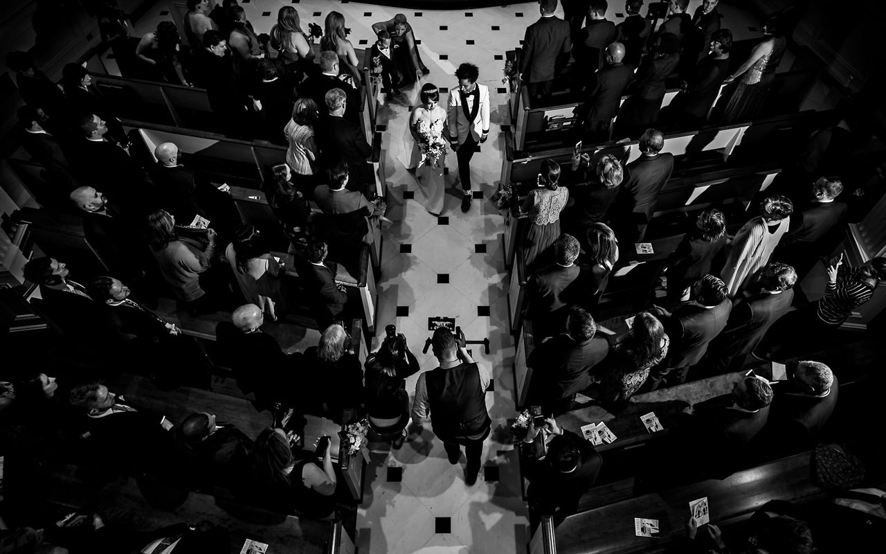 Overhead shot of bride walking down the aisle.