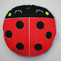 Screen printed ladybird cushion