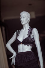 Mannequin wearing the undergarment with a bra