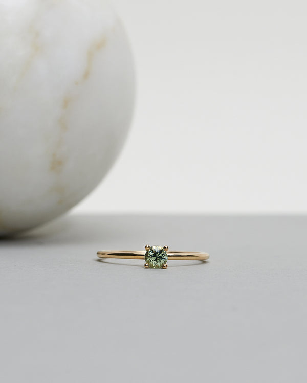Start bidding: Low Set Not At All Tiny Ring with an Olive Green Sapphire
