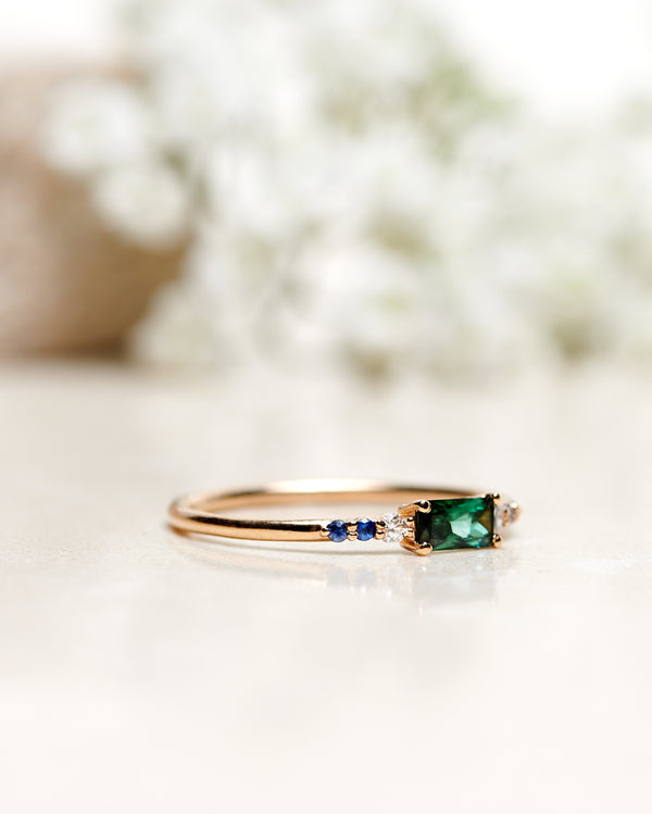 Finished: Cluster Ring with A Radiant-Cut Dark Green Tourmaline, Blue Sapphires and Diamonds (Total 0.36 CT)