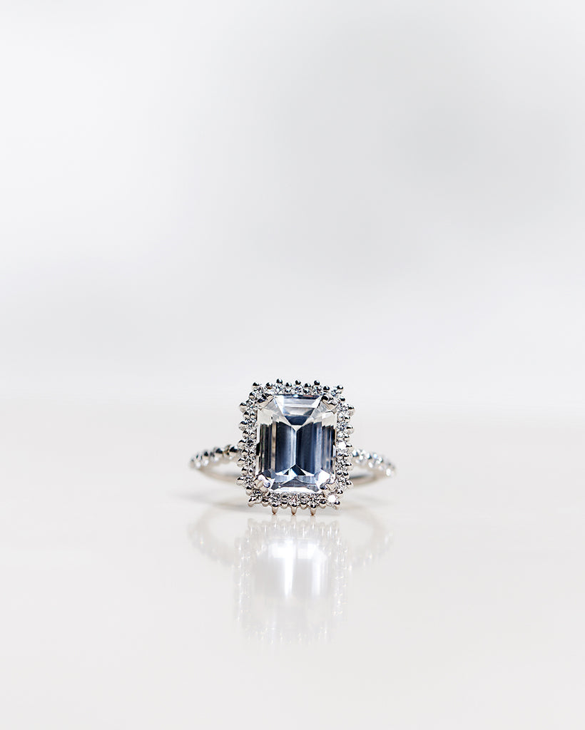 Emerald-Cut Diamond Halo Solitaire with Topaz and Brilliant Band (4.54 CT)