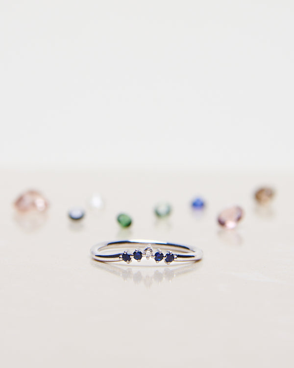 Finished: Five Diamond Triangle Ring in White Gold with Royal Blue Sapphires
