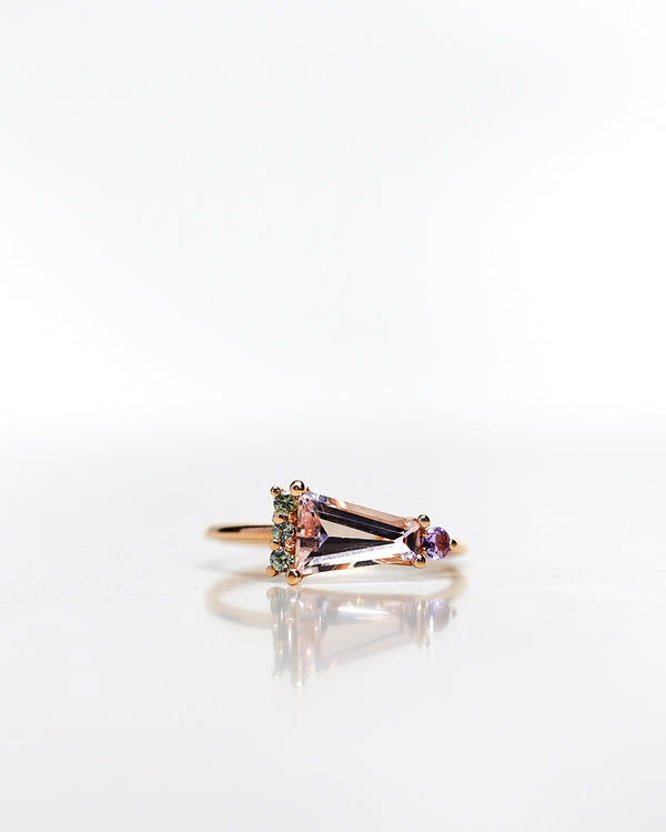 One-Of-A-Kind Art Deco Ring with a Trapezoid Cut Morganite, Olive Green Brilliant Sapphires and one Lavendel Sapphire (ca 1.21 CT)