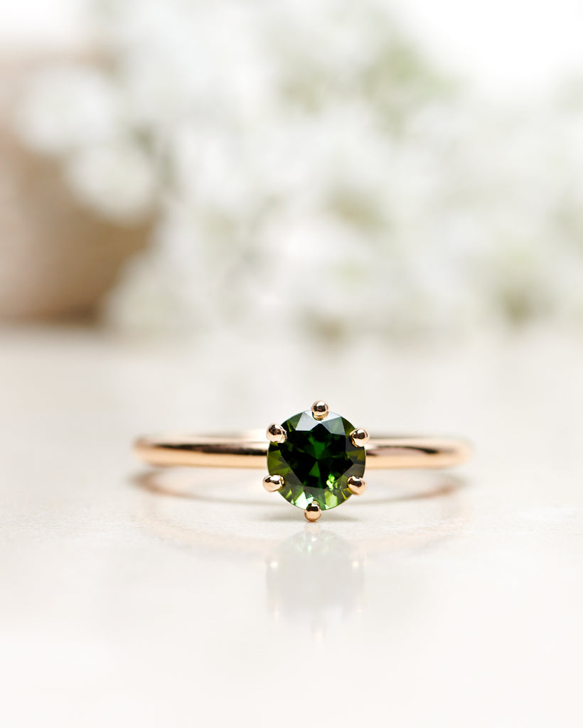 Finished: The Solitaire 0.75 CT with A Dark Green Tourmaline