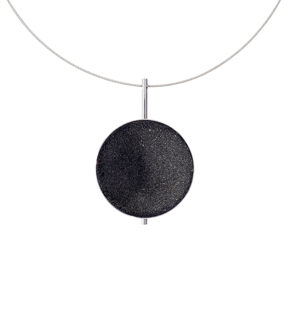 Necklace features authentic diamond dust embedded into a concrete lined stainless steel dome architecturally positioned onto a suspended minimalist steel post.