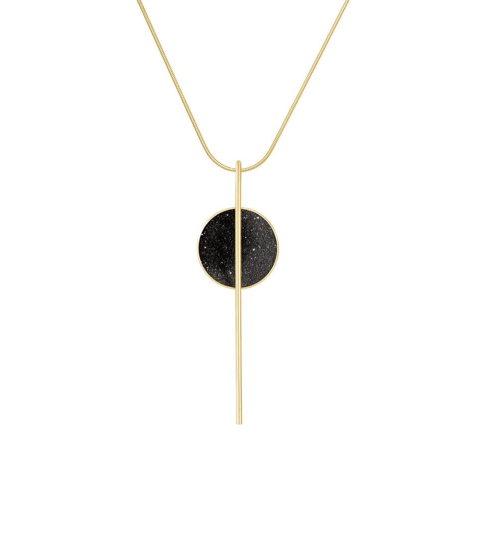 Elegant necklace sparkling with diamond dust infused blackened concrete set into a shallow 14 karat gold dome elegantly hanging from 14k gold rod and gold chain.
