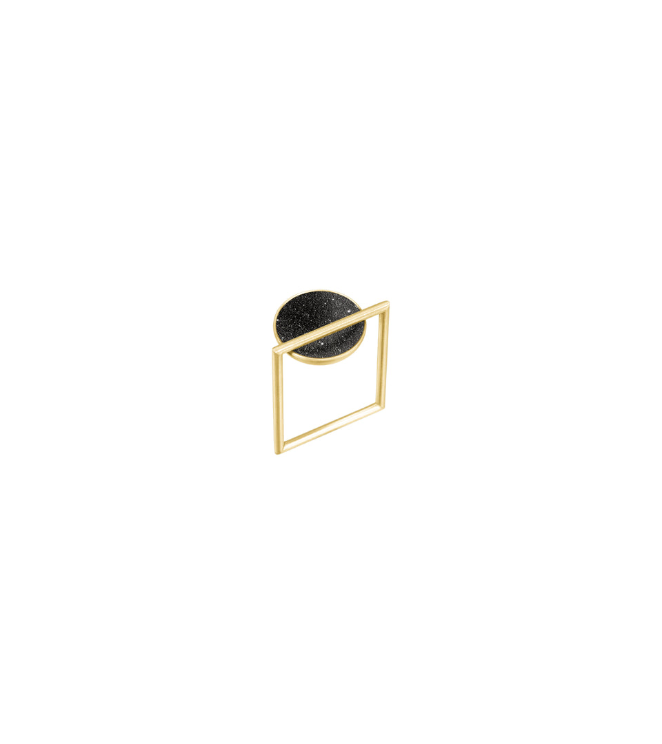 Contemporary jewelry featuring concrete and diamond dust set into a solid 14 karat gold dome architecturally suspended from a square gold ring.